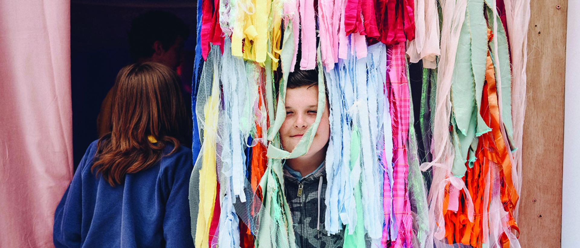 Children playing with colourful rags