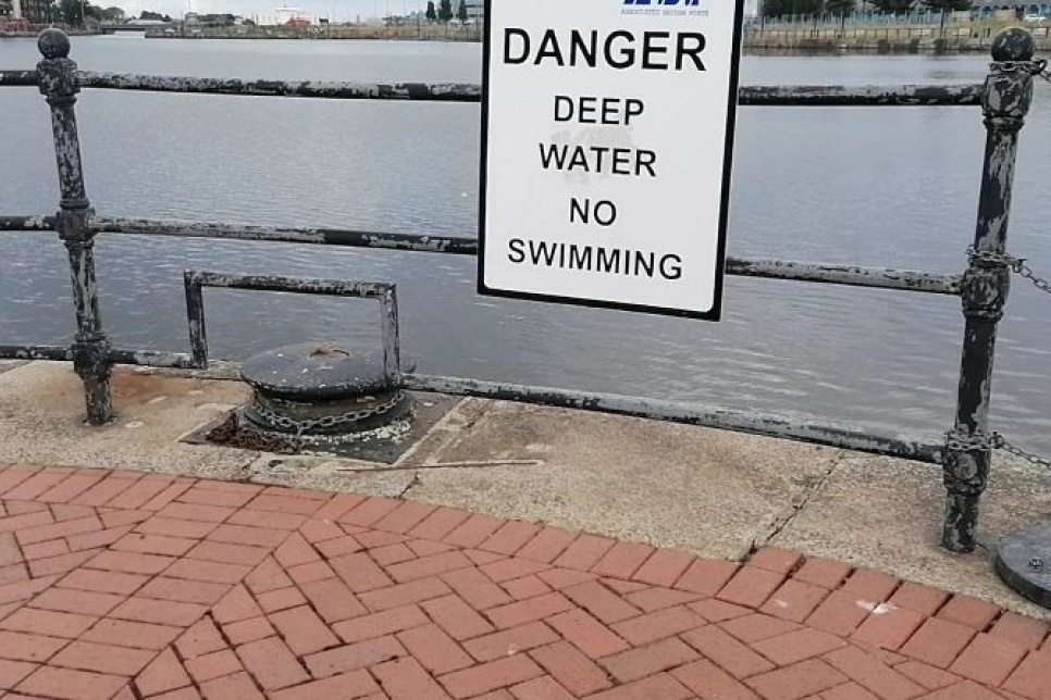 No swimming sign overlooking water